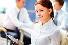 Business girl getting the basics of office work Stock Photos