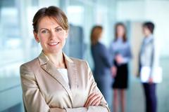 Portrait of a business woman on a good working day Stock Photos