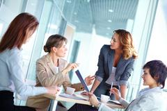 lovely business ladies gathered for a brainstorm - stock photo