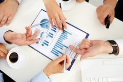 Close-up of a business team discussing graphs and charts Stock Photos