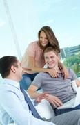 Vertical shot of a cheerful family meeting with the financial adviser Stock Photos