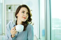 Image of a happy business woman enjoying the coffee-break Stock Photos
