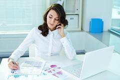 Image of a beautiful business lady in the middle of the workday Stock Photos