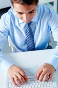 Above view of businessman working with laptop at workplace Stock Photos