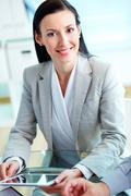 portrait of a female entrepreneur with digital pad at workplace - stock photo