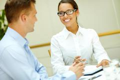 image of a beautiful office worker smiling to her male colleague - stock photo