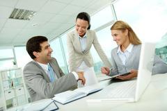 confident businesswomen explaining their ideas to employer at meeting - stock photo