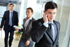 A handsome businessman calling by the phone in office Stock Photos