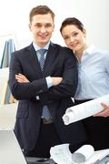 Portrait of successful colleagues looking at camera with smiles Stock Photos