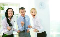 business people looking at camera and expressing their success - stock photo