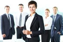 Pretty lady being a successful businesswoman at the head of a strong team Stock Photos