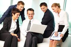 five business people working in office - stock photo