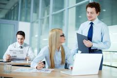 Portrait of business woman discussing ideas with her colleague Stock Photos