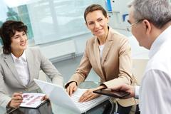 business group planning work in office - stock photo