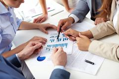 image of human hands over business documents at meeting - stock photo