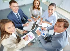 image of large group of confident partners looking at camera - stock photo
