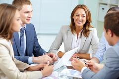 Image of business partners discussing plans at meeting Stock Photos