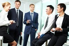 business people interacting with each other in semi-formal situation - stock photo