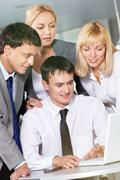 four business people working in office - stock photo