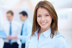 portrait of young smiling businesswoman looking at camera - stock photo