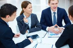 Stock Photo of portrait of business partners discussing new ideas at meeting