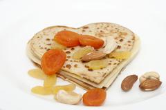 Heart-shaped pancake on white Stock Photos
