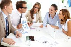 Stock Photo of image of confident partners sharing new ideas at meeting
