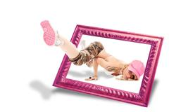 3d illusion of female dancer popping outside of a frame - stock photo