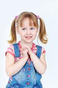 vertical portrait of a sweet girl in a denim jumpsuit - stock photo