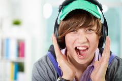Guy listening to music screaming out loud emotionally Stock Photos