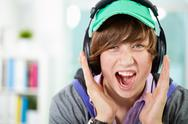 Stock Photo of guy listening to music screaming out loud emotionally