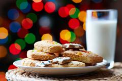 Image of tasty cookies on plate and a glass of milk Stock Photos