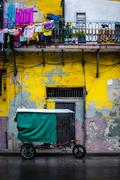 bycicle and shabby buildings in old havana - stock photo