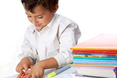 portrait of positive schoolkid playing school game in isolation - stock photo