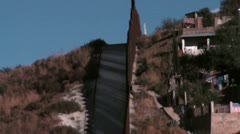 Stock Video Footage of Nogales Mexico border tilt down