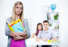 Portrait of pensive teenage blonde with school objects Stock Photos