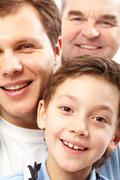 A vertical shot of three men belonging to different generations of the family Stock Photos