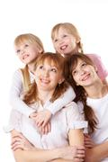 A young family of four over white background Stock Photos