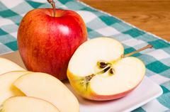 Gala apple sliced on a plate Stock Photos
