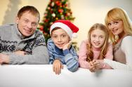 Portrait of four happy family members looking at camera with smiles Stock Photos