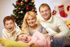 Portrait of four happy family members at home on christmas eve Stock Photos