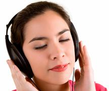 Stock Photo of listening to music with headphones