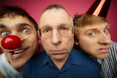 Three april fools looking at camera with different facial expressions Stock Photos