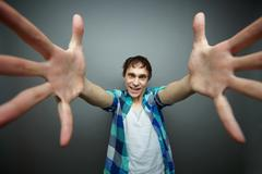 crazily looking man wanting to give a hug, april fools day series - stock photo