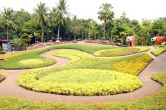 tourist attraction : a beautiful butterfly hill at nong nooch tropical botani - stock photo