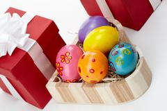 tilt up of an easter still-life with painted eggs and giftboxes - stock photo