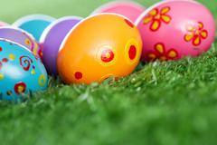 easter eggs lying on the lawn - stock photo