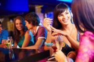 Stock Photo of portrait of pretty girls talking at party in the bar