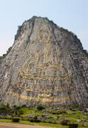 130 mtr high golden buddha laser carved and inlayed with gold on khao chee ch - stock photo