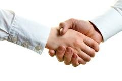 Image of female and male hands in a handshake Stock Photos